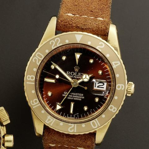 Rolex. A fine 18ct gold automatic calendar dual time wristwatch with transitional case and without crown guardsGMT-Master, Ref:1675, Serial No.900***, Circa 1960