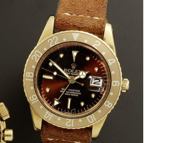 Rolex. A fine 18ct gold automatic calendar dual time wristwatch with transitional case and without crown guards  GMT-Master, Ref:1675, Serial No.900***, Circa 1960