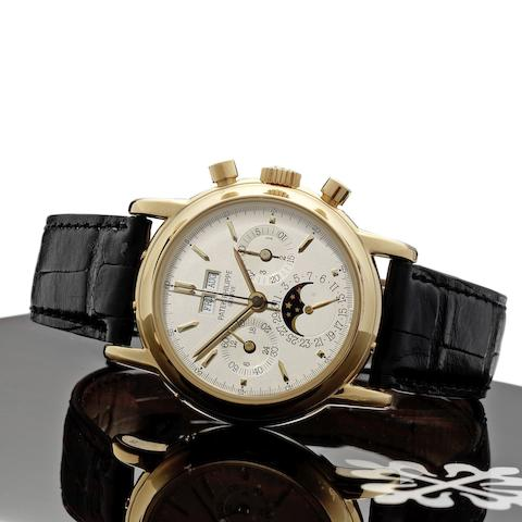 Patek Philippe. A fine and rare 18ct gold perpetual calendar chronograph wristwatch with phases of the moon and Certificate of Origin Ref:3970, Case No.2919333, Movement No.876291, Sold 23rd December 1992