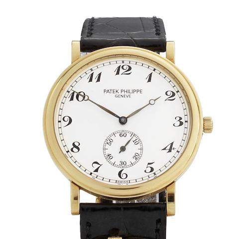 Patek Philippe. An 18ct gold manual wind wristwatch with Certificate of Origin  Ref:5022J-013, Case No.4096036, Movement No.1869851, Circa 1991