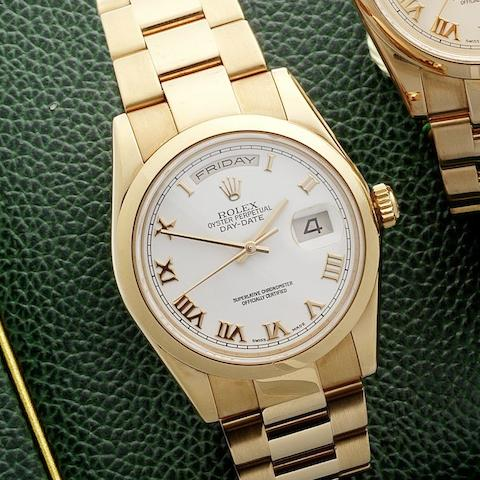 Rolex. An 18ct rose gold automatic calendar bracelet watchDay-Date, Ref:118205, Serial No.K957***, Movement No.39161188, Circa 2001