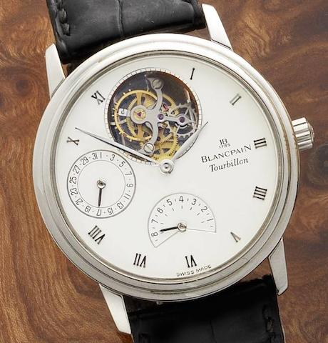 Blancpain. A fine platinum manual wind tourbillon calendar wristwatch with power reserve, together with fitted box and papersNo.42, Ref:0023.3427.55, Sold 19th January 1993