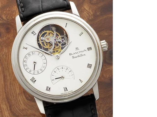 Blancpain. A fine platinum manual wind tourbillon calendar wristwatch with power reserve, together with fitted box and papers No.42, Ref:0023.3427.55, Sold 19th January 1993
