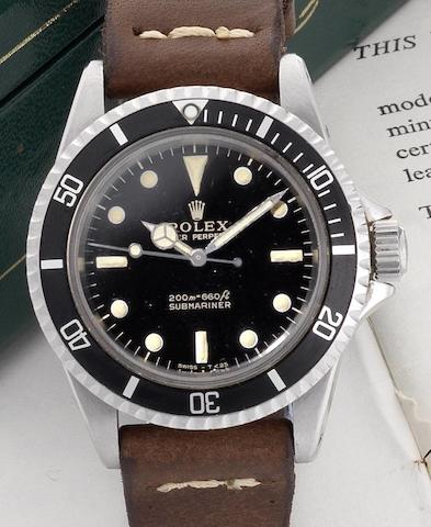 Rolex. A fine stainless steel automatic wristwatch with original Rolex box and papers  Submariner, Ref:5513, Serial No.119****, Made in 1965, Sold 12th March 1966