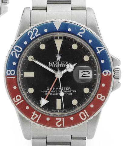 Rolex. A stainless steel automatic calendar bracelet watch with 2nd time zone indication and with box and papers GMT-Master, Ref:16750, Serial No.823****, Sold 15th December 1983