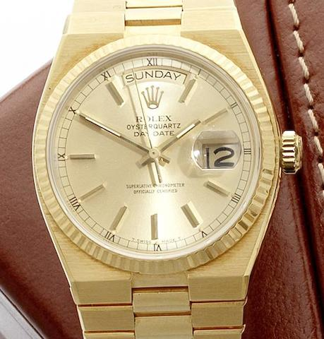 Rolex. A fine 18ct gold quartz calendar bracelet watch with box and papers Oysterquartz Day-Date, Ref:19018, Serial No. 6296***, Sold 2nd June 1981