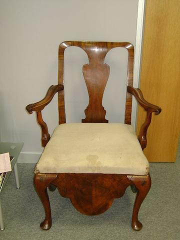 A Queen Anne walnut commode chair