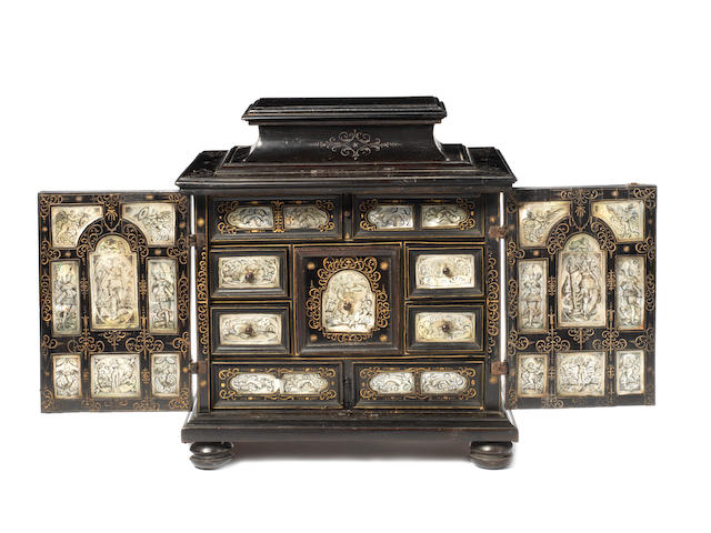 An early to mid-17th century Dutch ebony-veneered and engraved mother of pearl small table or spice cabinet, possibly AmsterdamThe engraving in the manner of Jan Bellekin (Amsterdam, fl. 1600 - 1625)