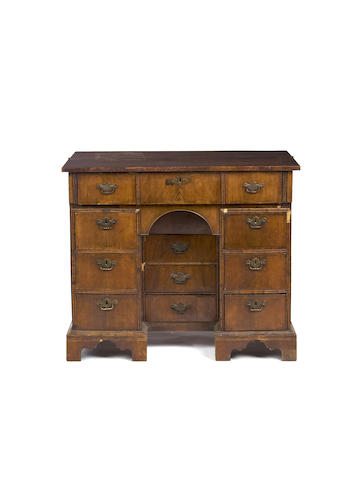 A George I and later, walnut secretaire kneehole desk