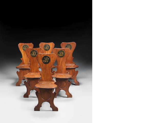A set of six George II mahogany hall chairs