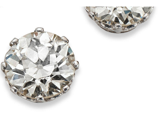 A pair of single-stone diamond earrings