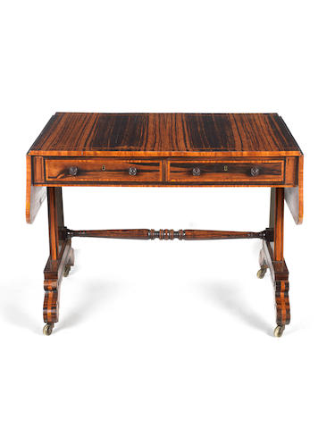 A Regency calamander and satinwood inlaid sofa table