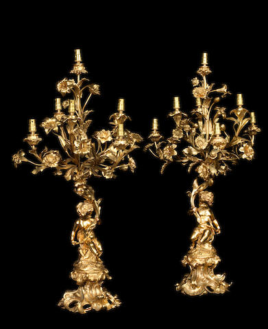 A pair of French late 19th/early 20th century gilt bronze seven-light candelabra