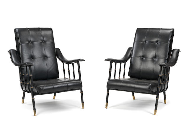 Jacques Adnet A Pair of Armchairs circa 1950  stitched black leather and gilt brass  Height: 90 cm.                35 7/16 in.   Retailed through 'La Compagnie des Arts Francais' France