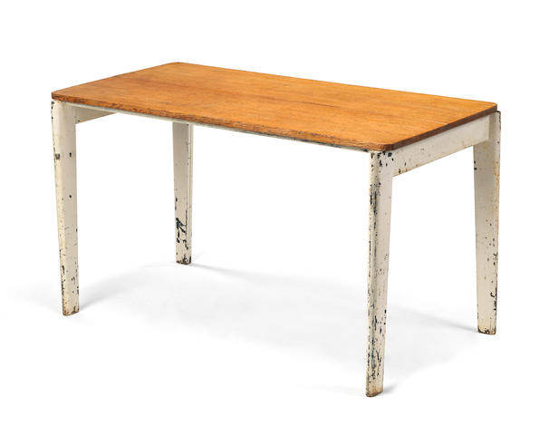 Jean Prouvé Table spéciale designed 1946 for the Société des Houillères de Sarre et Moselle  enamelled bent steel and oak  70 by 122 by 60 cm. 27 9/16 by 48 1/16 by 23 5/8 in.