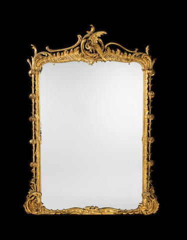 A large William IV rococo revival carved giltwood overmantel mirror