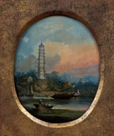 Circle of George Chinnery RHA (British, 1774-1852) A Chinese river scene with pleasure boat and junk before a landscape, oval