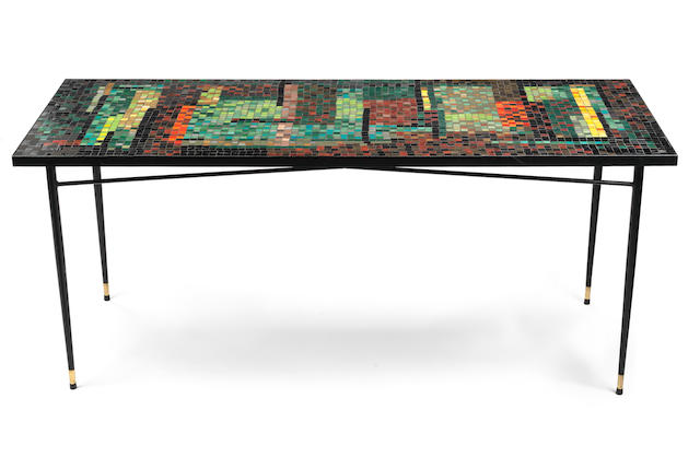 John Piper Dining Table circa 1960  signed John Piper to one tile ceramic mosaic, ebonised metal and brass  76.5 by 184 by 77 cm. 30 1/8 by 72 7/16 by 30 5/16 in.