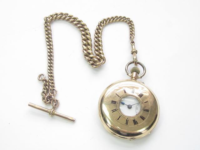 A half hunter pocket watch and an Albert watch chain
