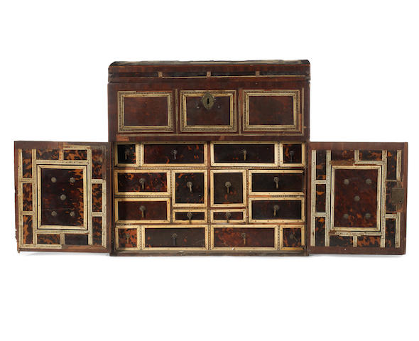 A Spanish early 18th century walnut, tortoiseshell and ivory and ebony-inlaid table cabinet