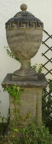A pair of George III stone garden urns