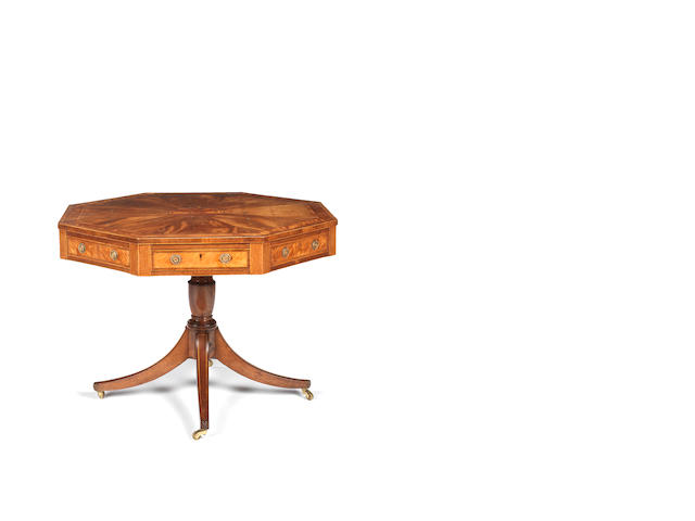 A George III mahogany, satinwood and tulipwood banded octagonal library table