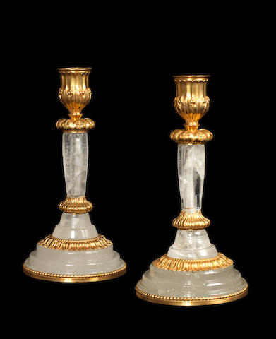 A pair of late 19th century rock crystal and gilt-bronze candlesticks