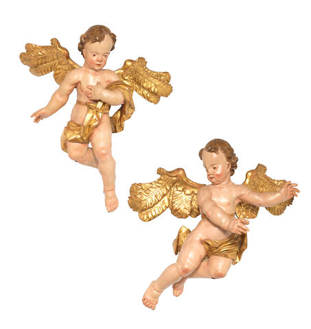 A pair of South German 18th century carved wood, parcel-gilt and polychrome-decorated putti