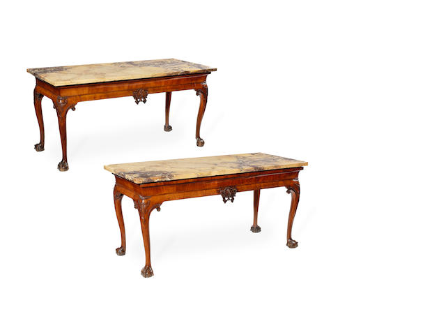 A pair of walnut side tables