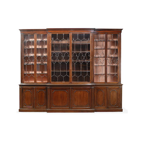 A large late 19th century mahogany breakfront library bookcase in the George III style