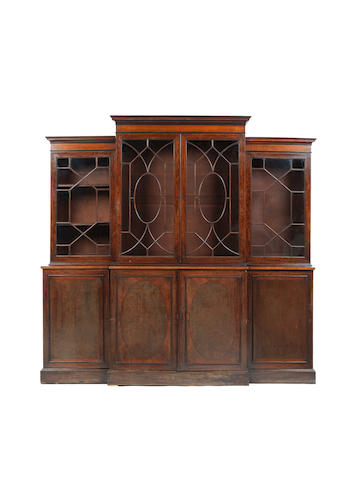 A George III mahogany and rosewood crossbanded breakfront library bookcase