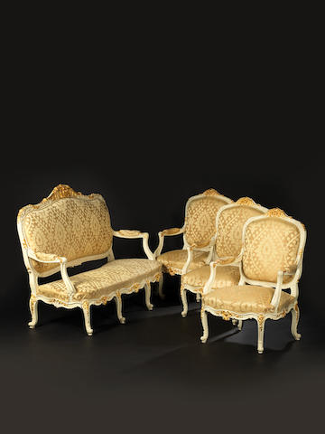 A French early 20th century Louis XV style gilt and white painted four-piece salon suite