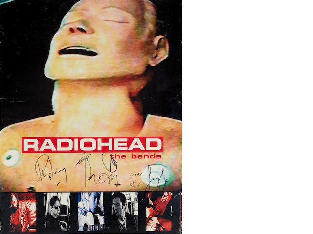 Radiohead: an autographed poster and CD insert,