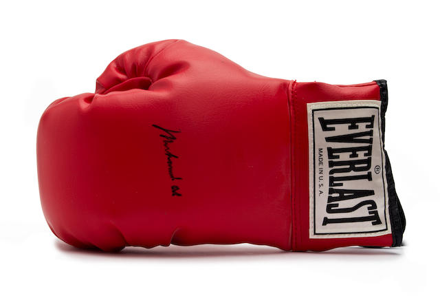 A Muhammad Ali hand signed boxing glove