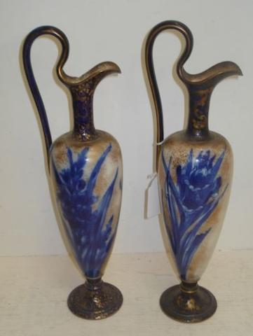 A pair of Doulton Burslem classical vase shape ewers, decorated in blue with flowers on a gilt speckled ground, printed and impressed marks, 38cm.