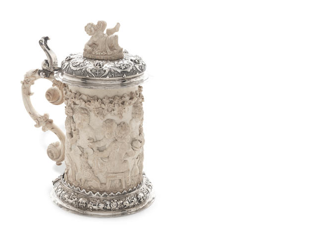 A 19th century German silver-mounted and carved ivory tankard stamped with pseudo 18th century marks, second half of 19th century