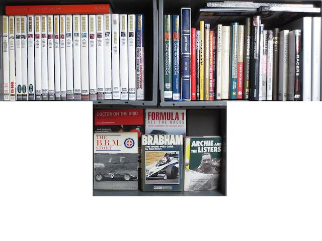 Twenty-two Autocourse annuals and other motorsport books including signed examples,