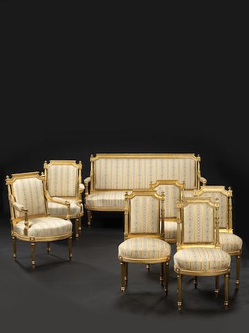 A French late 19th century Louis XVI-style giltwood seven-piece salon suite in the manner of Georges Jacob