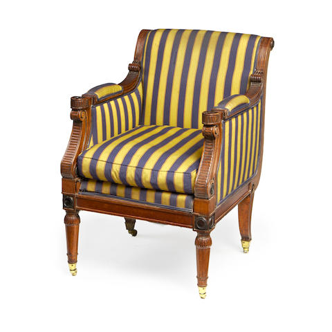 A mahogany and ebonised library armchair in the Regency style