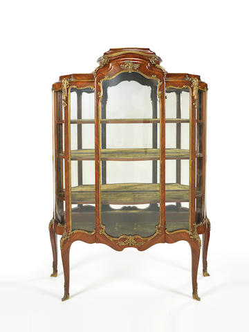 A French late 19th century ormolu-mounted tulipwood vitrineby Paul Sormani, Paris