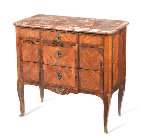 A French 18th century Transitional kingwood, tulipwood and marquetry breakfront commode