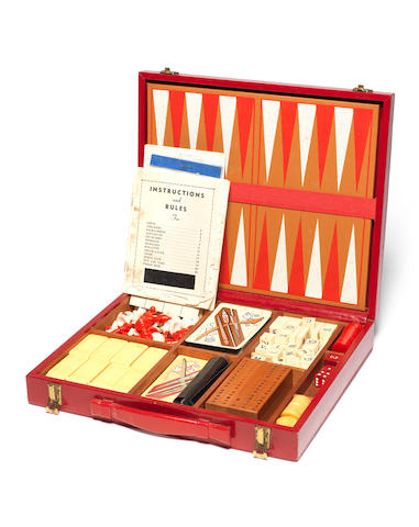 Vivien Leigh: A red leather bound personalised games compendium with gilt monogram to front VLO, owned by Vivien Leigh,