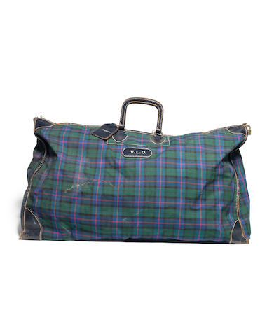 Vivien Leigh Olivier: A tartan canvas duffle bag with leather detail and badge initialed VLO,