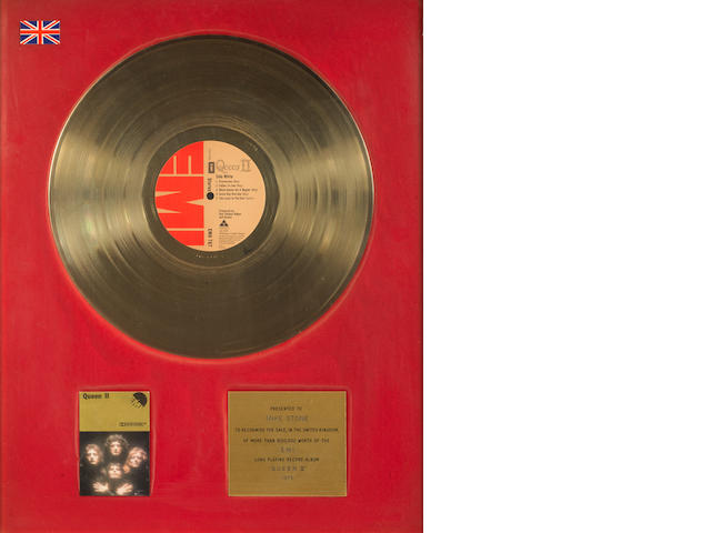 Queen: an EMI Gold in-house award for the album 'Queen II',  1975, presented to Mike Stone,