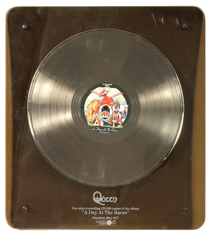 Queen: an EMI Dutch in-house award for the album 'A Day At The Races',  May 1977, presented to Mike Stone,