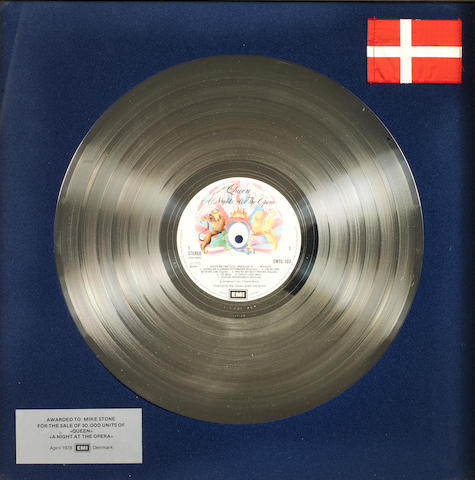 Queen: a Danish EMI in-house award for the album 'A Night At The Opera',   April 1978, presented to Mike Stone,