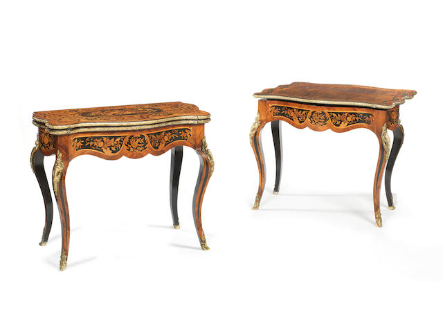 A pair of Louis XV-style lacquered brass-mounted, kingwood, walnut, ebonised and floral marquetry fold-over swivel-action card tables