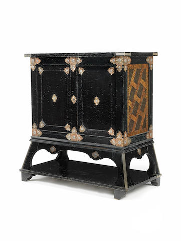 An American copper inlaid ebonised cabinet