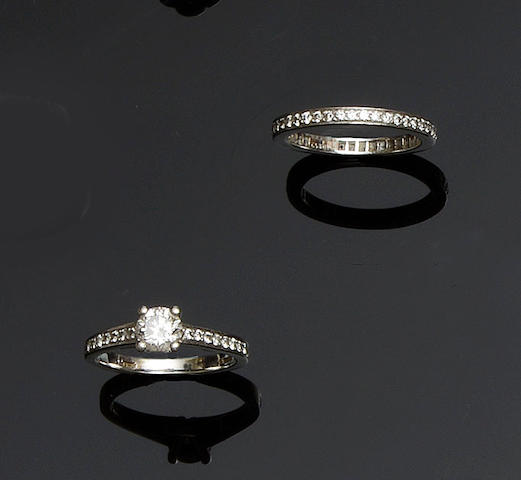 A diamond single stone ring and a diamond full hoop eternity ring (2)