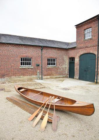 An early 20th Century 16ft carvel built Canadian canoe